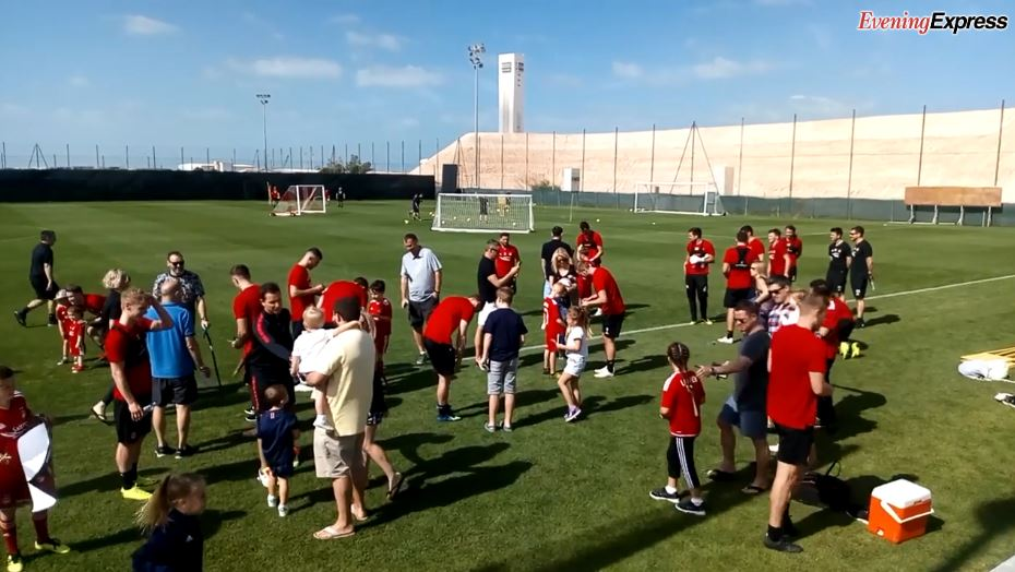 Aberdeen players mingling with expat fans in Dubai.