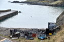 Cove Harbour, where a number of boats were destroyed in a fire last weekend