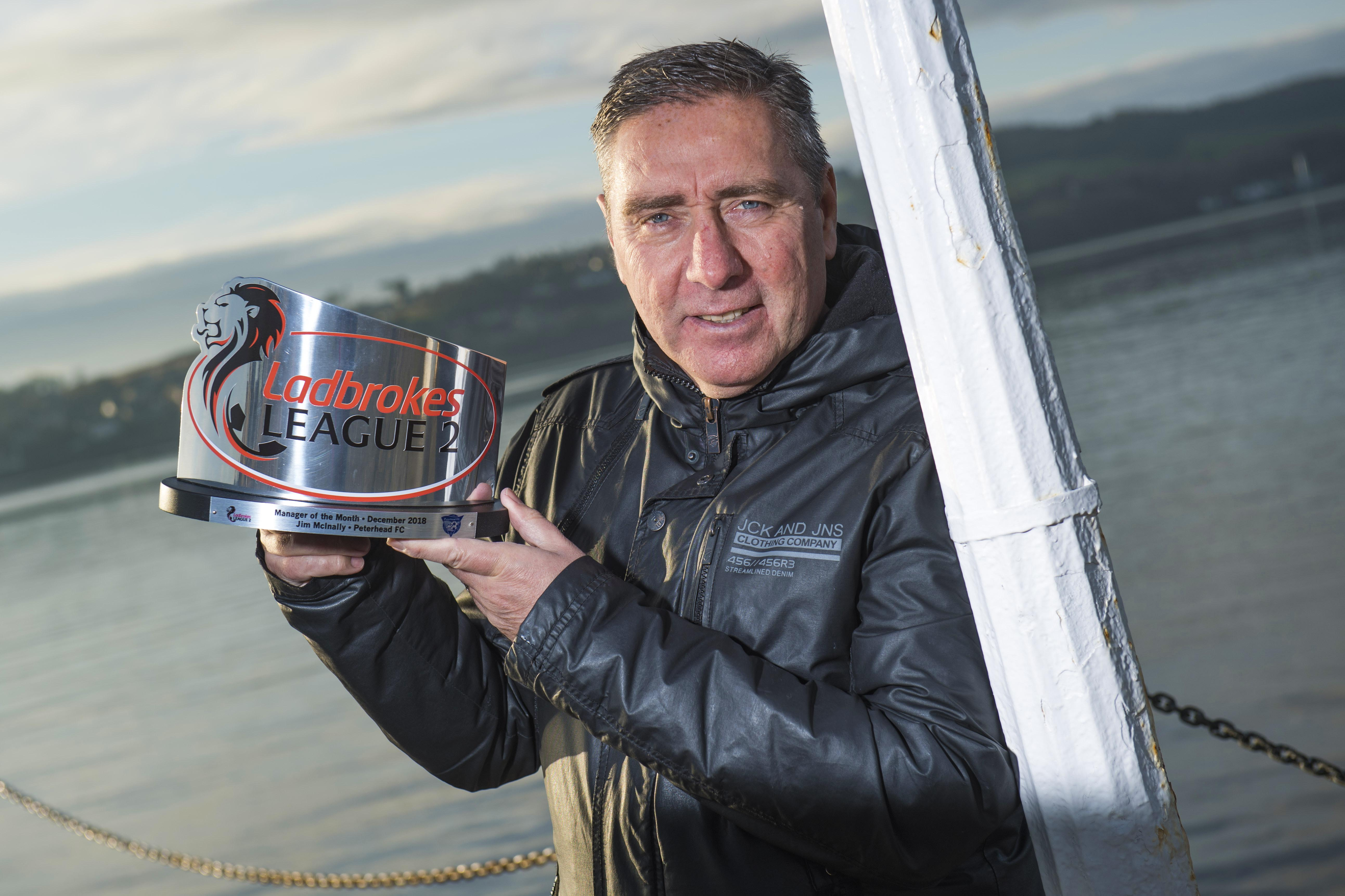 Peterhead manager Jim McInally receives his Ladbrokes League Two Manager of the Month award for December.