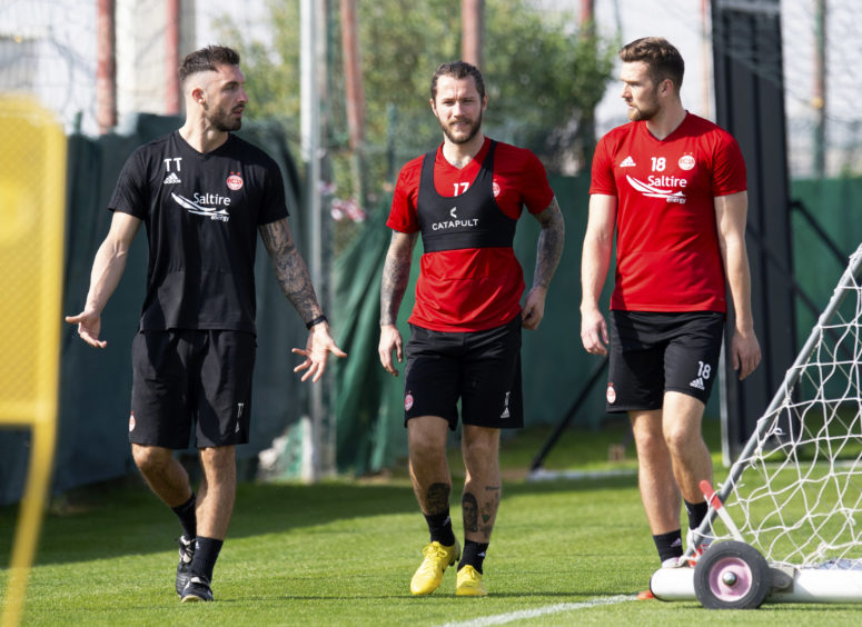 Aberdeen physio Tony Tompos (left) with Stevie May and Michael Devlin.