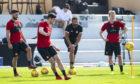 Aberdeen Manager Derek McInnes with Graeme Shinnie, Scott McKenna and Gary Mackay-Steven.