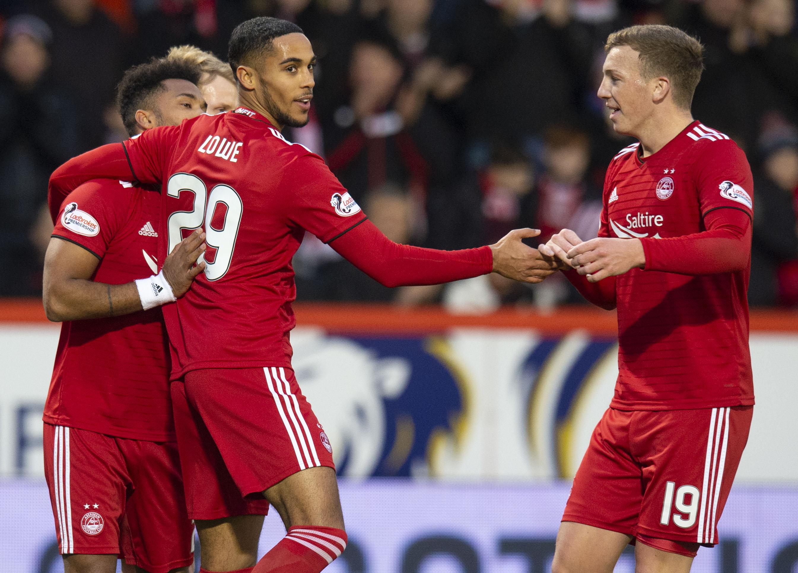 Aberdeen's Max Lowe, left, celebrates his goal.