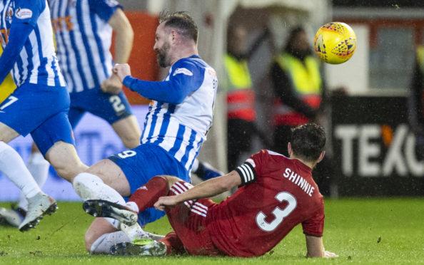 Kilmarnock's Kris Boyd makes the challenge on Aberdeen's Graeme Shinnie which earns the striker a red card
