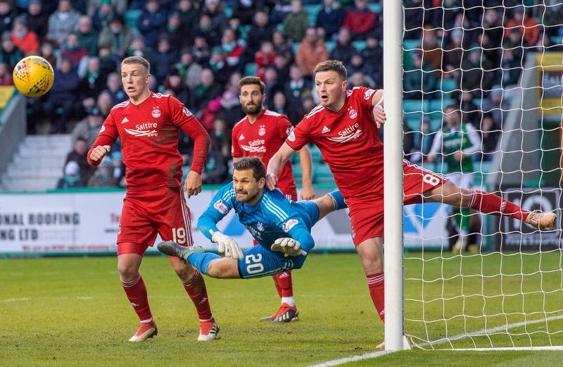 Aberdeen's Tomas Cerny pushes a shot away.