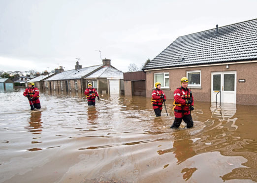 Emergency workers at storm-hit Port Elphinstone three years ago