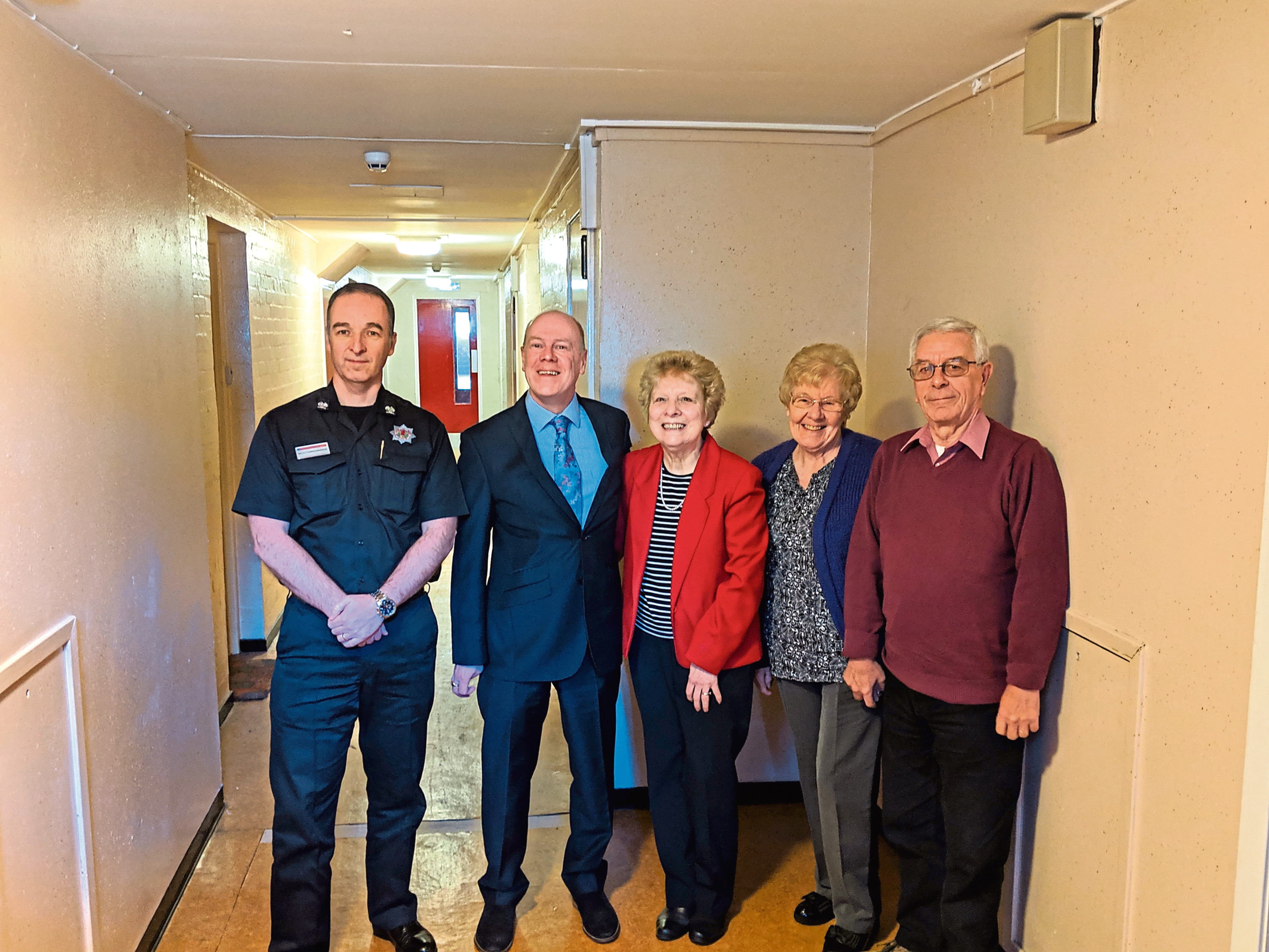 Scottish Fire and Rescue Service's senior officer Bruce Farquharson with MSP Kevin Stewart, Thistle Court residents Leonora Montgomery, Mary McMann and John McMann