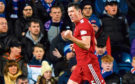 Aberdeen's Scott McKenna celebrates after opening the scoring against Rangers at Ibrox in December