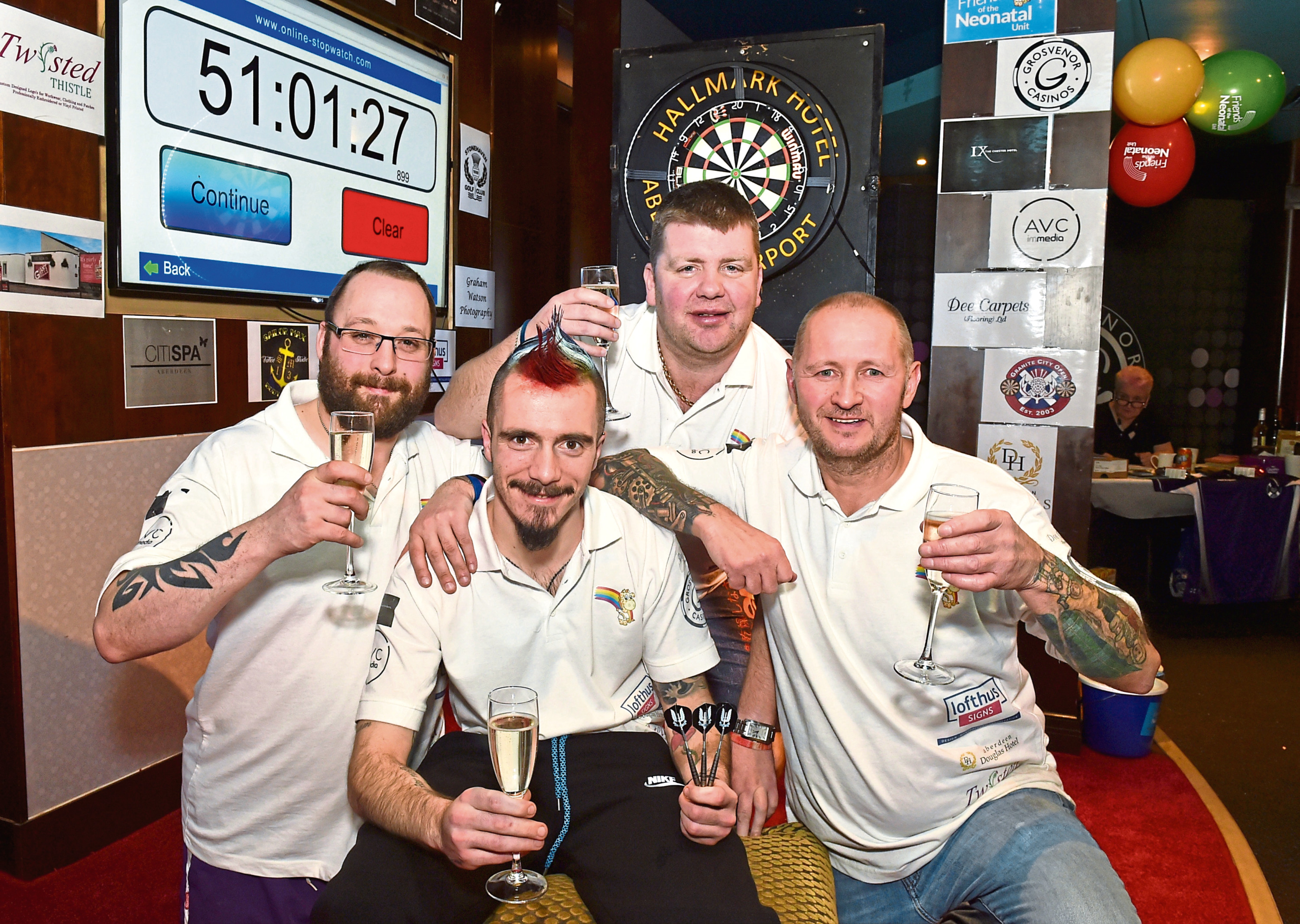 Record-breaking darts fundraisers, from left, Dave Matthew, Lewis Grant. Neil Munro and Mark Taylor