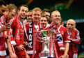 Aberdeen's (L/R) Andrew Considine, Barry Robson and Nicky Low celebrate with the League Cup trophy in 2014.