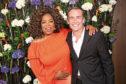 Grant Martin with Oprah Winfrey
