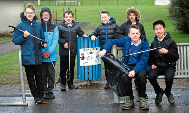 Kids at Danestone Primary School have designed posters asking people not to litter in their playground