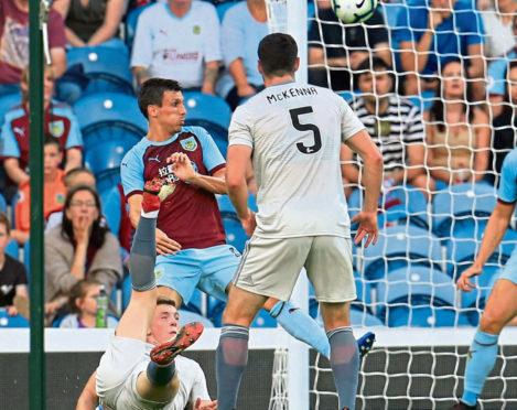 Lewis Ferguson scores an overhead kick against Burnley.