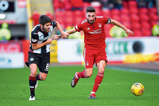 St Mirren's Ryan Flynn, left, in action with Aberdeen's Graeme Shinnie.