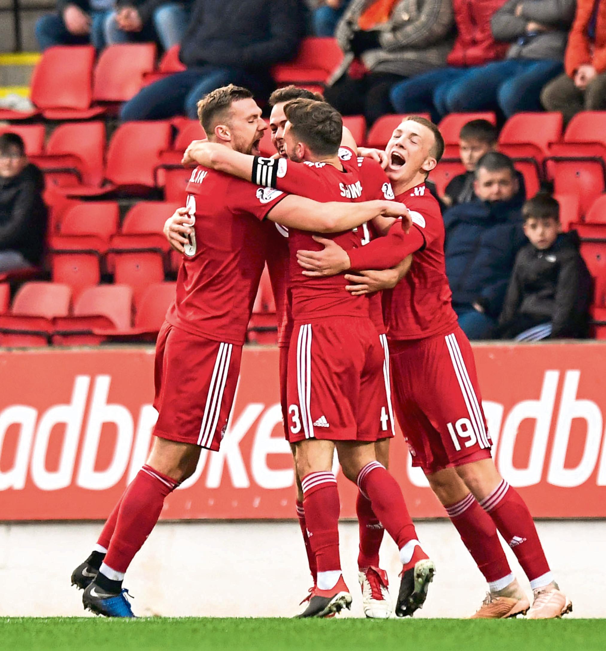Aberdeen's Graeme Shinnie celebrates a goal with his team mates
