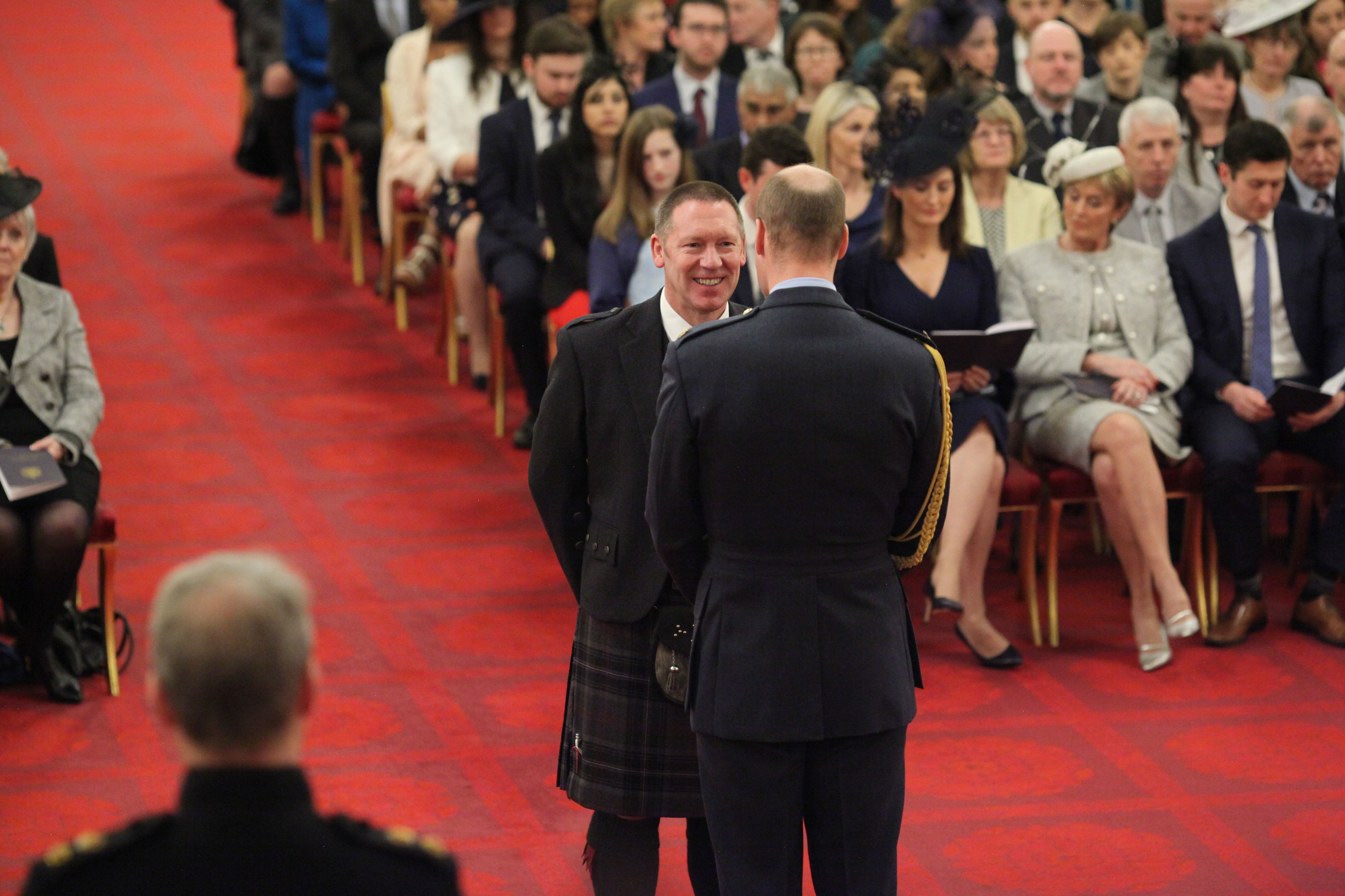Area Manager David Rout from Ellon is decorated with the Queen's Fire Service Medal by the Duke of Cambridge
