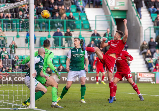 Aberdeen's Andrew Considine scores to make it 1-1.