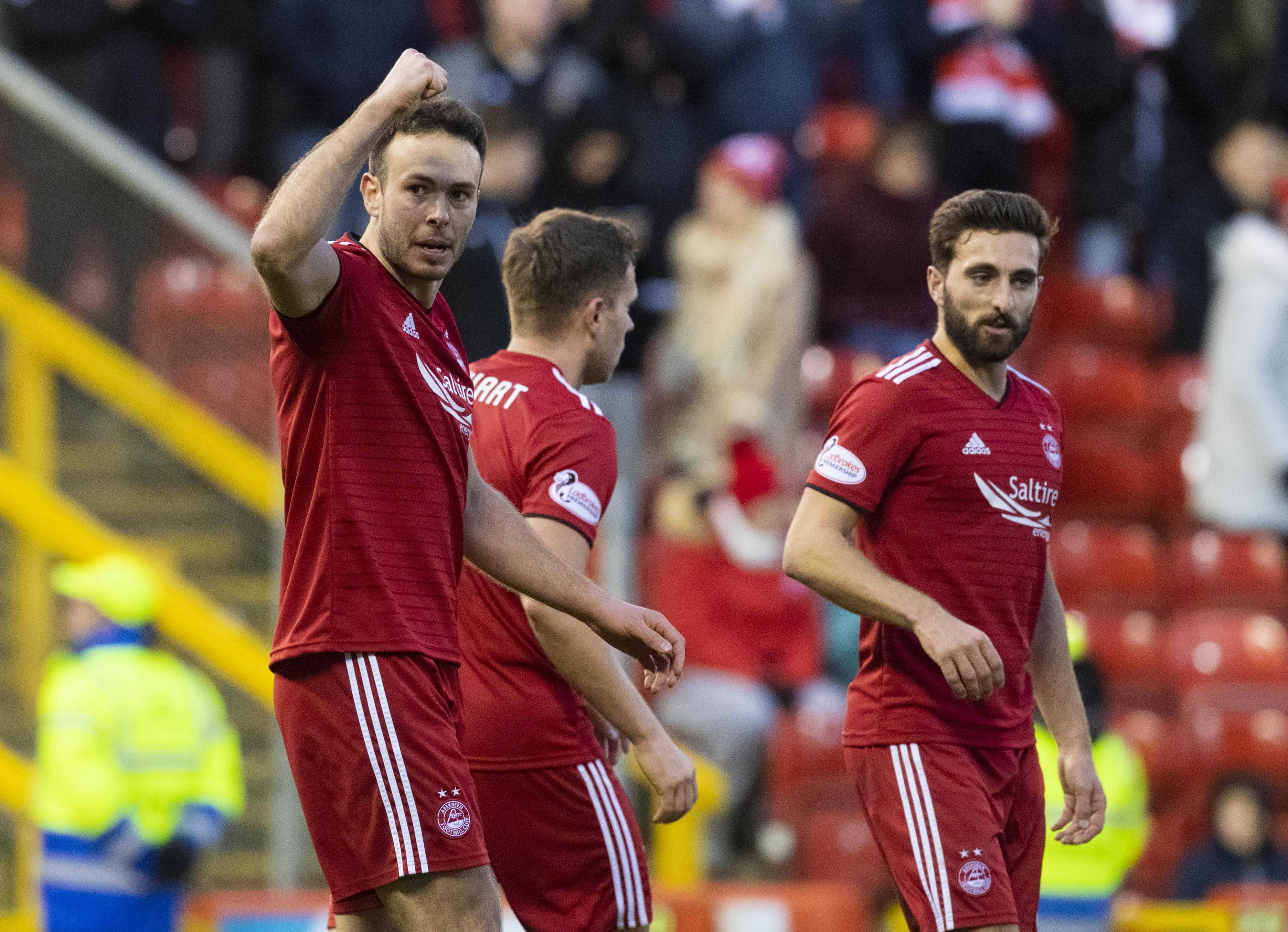 Aberdeen's Andrew Considine celebrates his goal against Queen of the South.