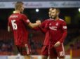 Aberdeen's Sam Cosgrove celebrates with fellow goalscorer Niall McGinn in the 4-1 Scottish Cup defeat of Queen of the South.