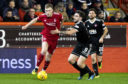 Aberdeen's Sam Cosgrove in action.