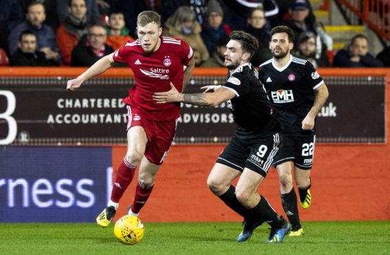 Aberdeen's Sam Cosgrove in action.