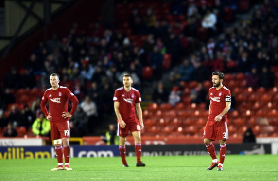 Pictured are Aberdeen's Lewis Ferguson, Tommie Hoban and Graeme Shinnie after Rangers scored to make it 1-2 Picture by DARRELL BENNS  Pictured on 06/02/2019
