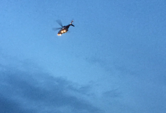 A helicopter circles over Bridge of Don tonight. Picture by Jacqui Watson