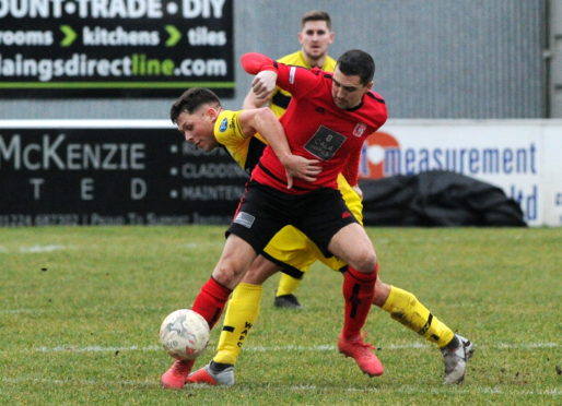 Picture of Wick's Jack Henry (left) and Inverurie's Neil McLean Picture by KENNY ELRICK
