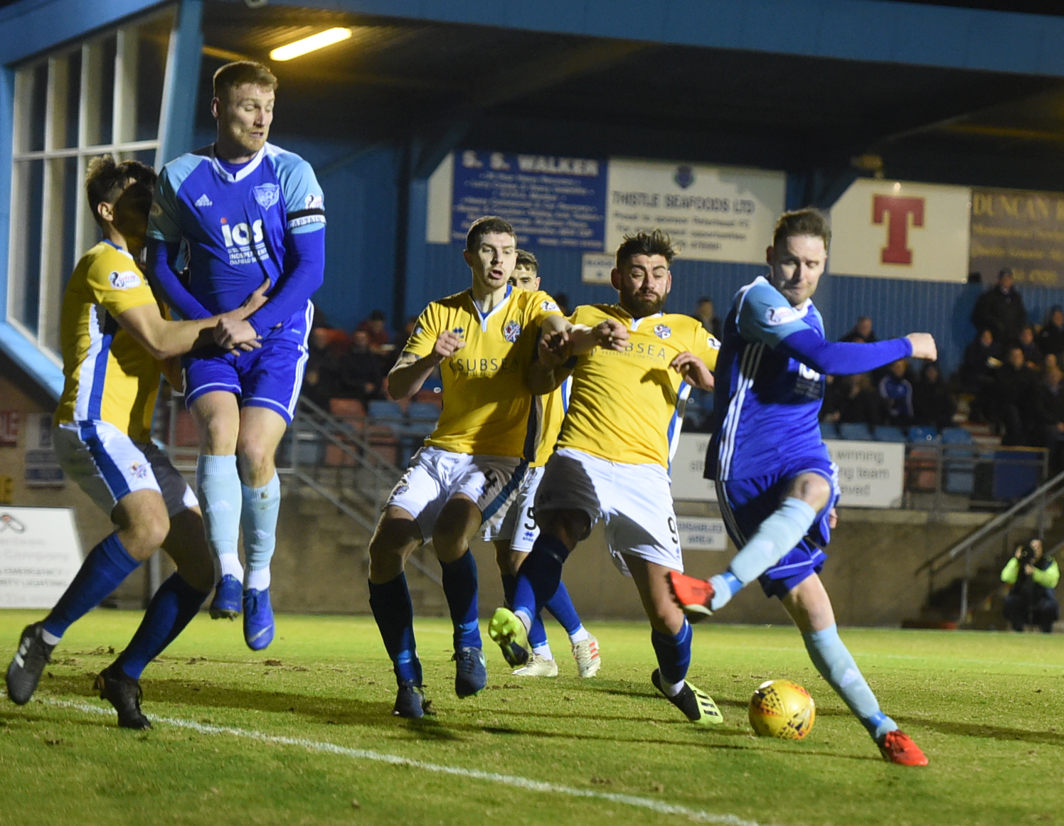 Peterhead's Mick Dunlop (right) shoots at goal during the game with Cowdenbeath Picture by Jim Irvine