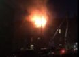 Huge flames were seen coming from the roof of the property on Richmond Street