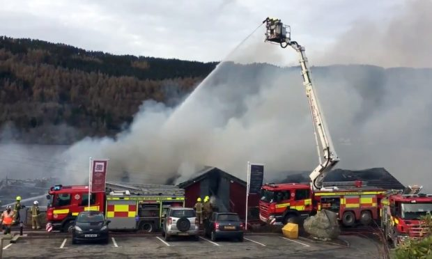 Firefighters battling the blaze at Taymouth Marina.