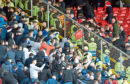 A seat appears to be thrown towards Dons fans at the game