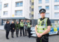 """Police hope visiting the high rises will help them open up """"lines of communication"""" with the locals"""