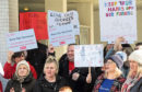Protesters against funding cuts gathered outside the council meeting