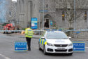 Police at the scene of the ram raid at Scotmid in Torphins