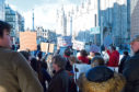 A number of voluntary groups protested about the planned council cuts outside the Town House as councillors were meeting