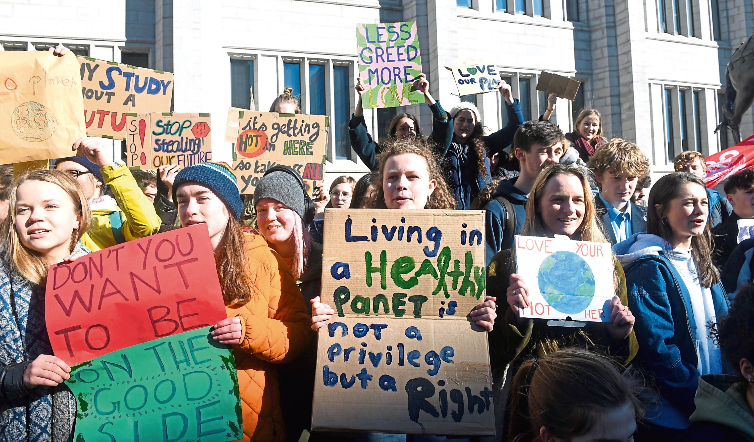 A group of young people, including students and school pupils held a protest in front of Marischal College against climate change.