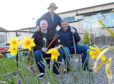 From left, Bryan Hall, Paul O'Connor and Kellas Midstream's Alan Murray at the Inchgarth Community Centre garden