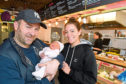 Jerry O'Driscoll with his baby daughter Ayda and Muchacho manager Jenny Suniaga