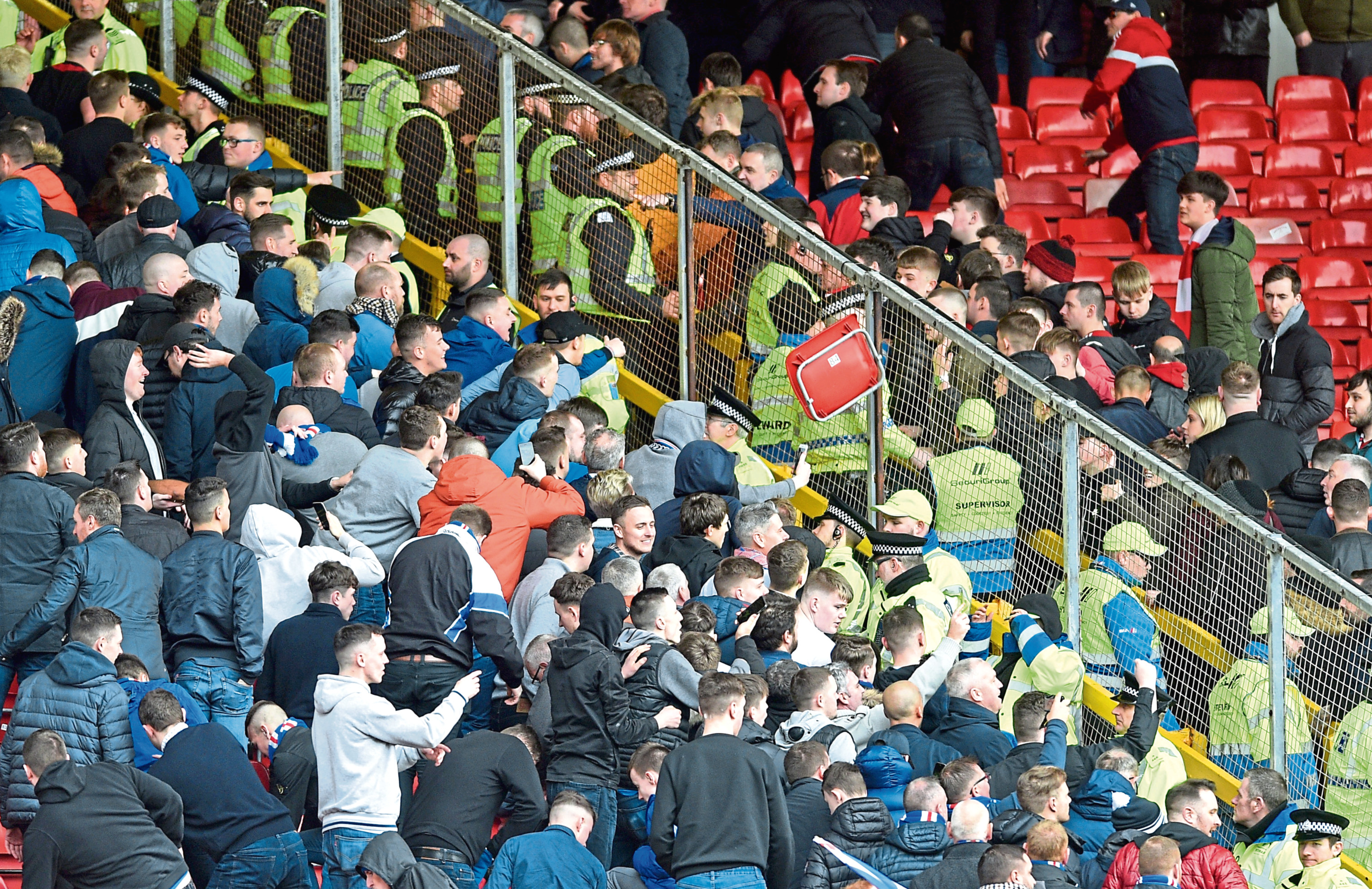 A seat is thrown into the Aberdeen area of fans after full time