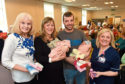 Sandra Gall, Michelle Leye and Stewart Gray with their newborns William and Eddie Gray and Senior Charge Midwife Kylie Williamson