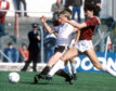 Aberdeen's Frank McDougall, left, is tackled by Craig Levein at Tynecastle.