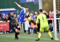 Rory McAllister attempts a shot.