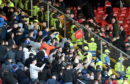 Trouble in the stands at Pittodrie as a seat is thrown into the Aberdeen area of fans after full-time. Picture by Darrell Benns