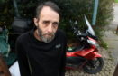 Stuart Walker pictured with his damaged scooter