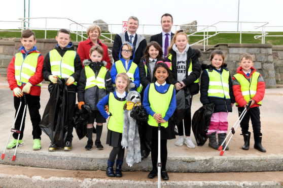 Pupils from schools across the city have joined forces to clean up Aberdeen