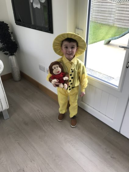 Ellis Hastie, 4, as The Man with the Yellow Hat from Curious George