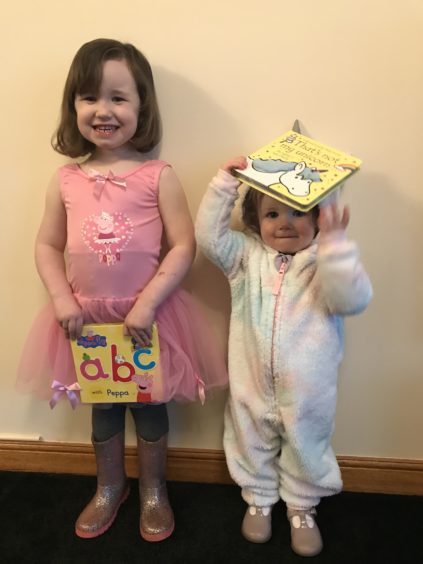 Elise Simpson, 3, and Paige Simpson, 20 months, as Peppa Pig and a unicorn