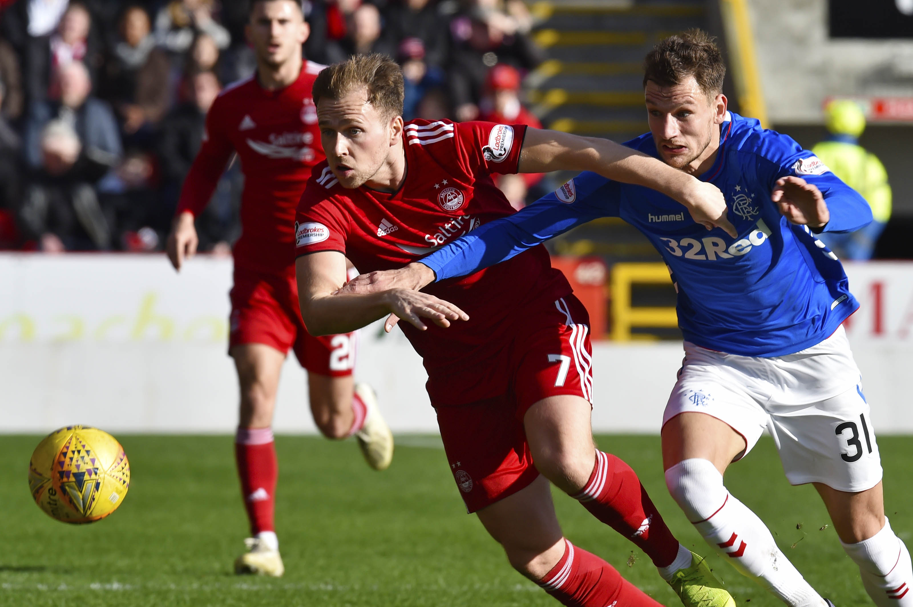 Aberdeen's Greg Stewart, left, competes with Rangers' Borna Barisic.