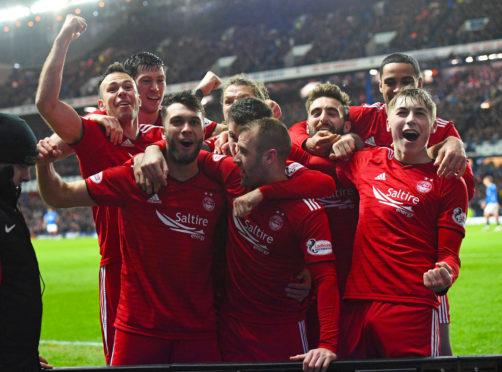Aberdeen's Connor McLennan (left) celebrates his goal against Rangers