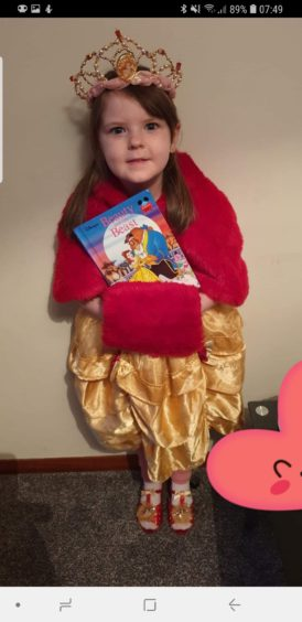 Jessica May, 6, in her outfit inspired by Beauty and the Beast's Belle